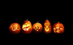 halloween five carved pumpkins jack o lanterns lights glowing holiday